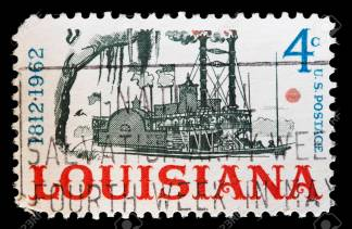 UNITED STATES OF AMERICA - CIRCA 1962: A used postage stamp printed in United States shows a steamboat on the Mississippi, one of the symbols of the state of Louisiana, circa 1962
